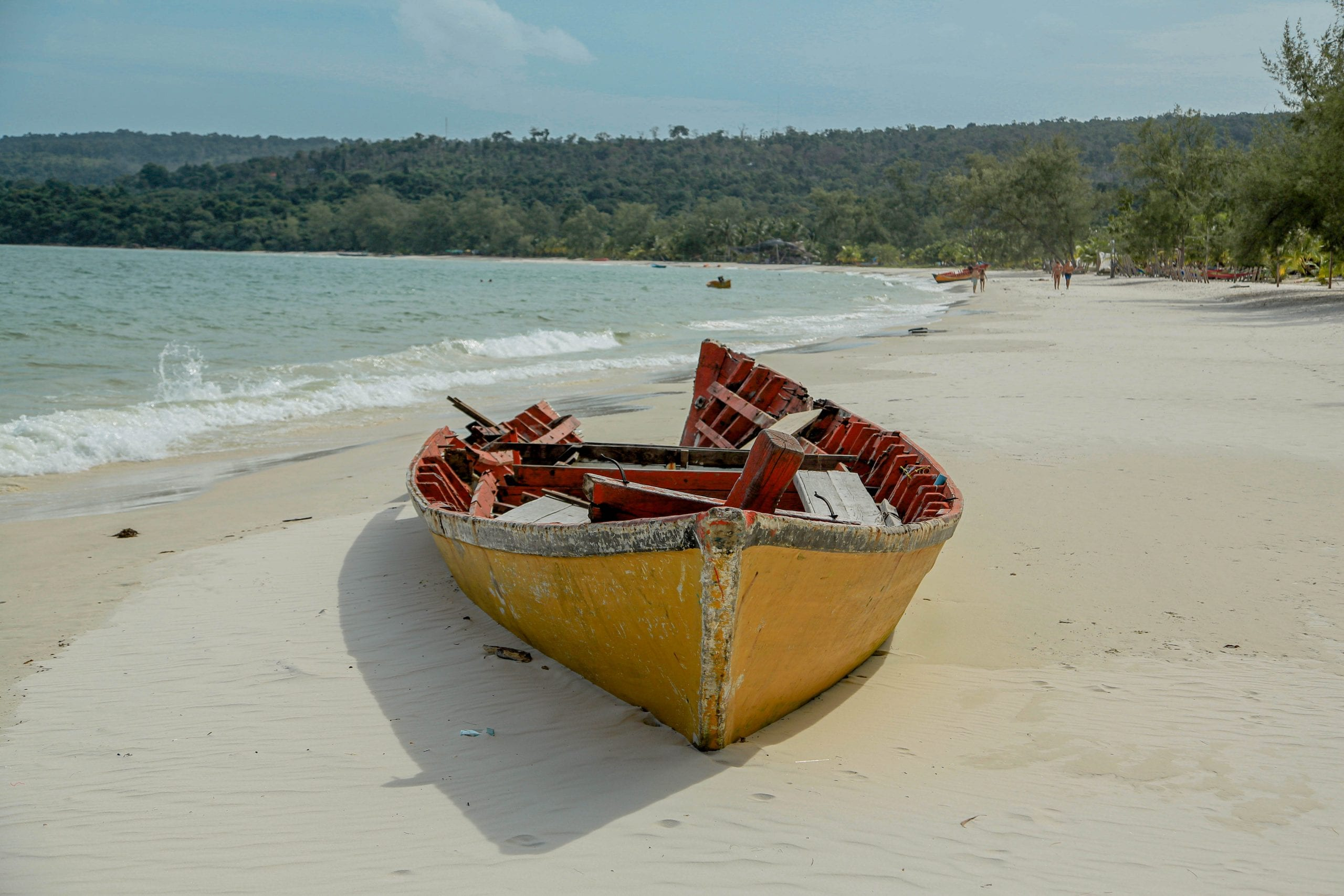 Boat on a empty beach on Koh Rong, Cambodia