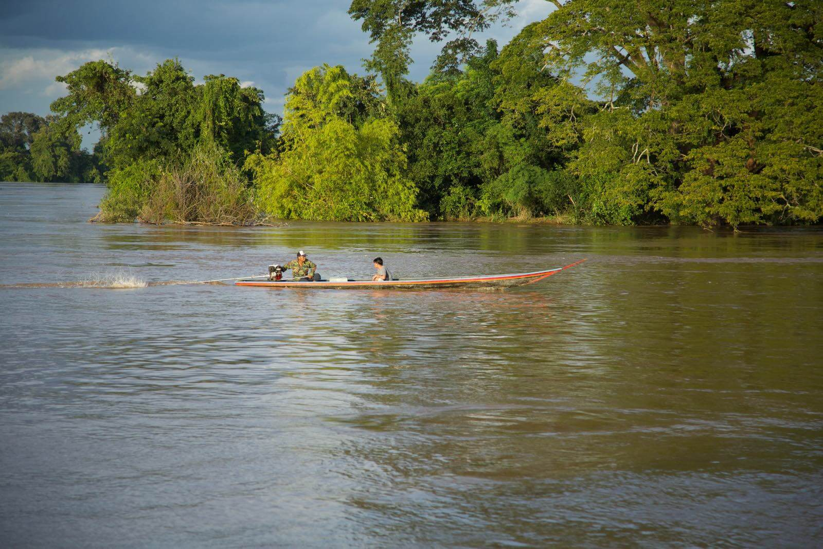 Men driving a small boat on the Mekong River in Don Det, Laos-2