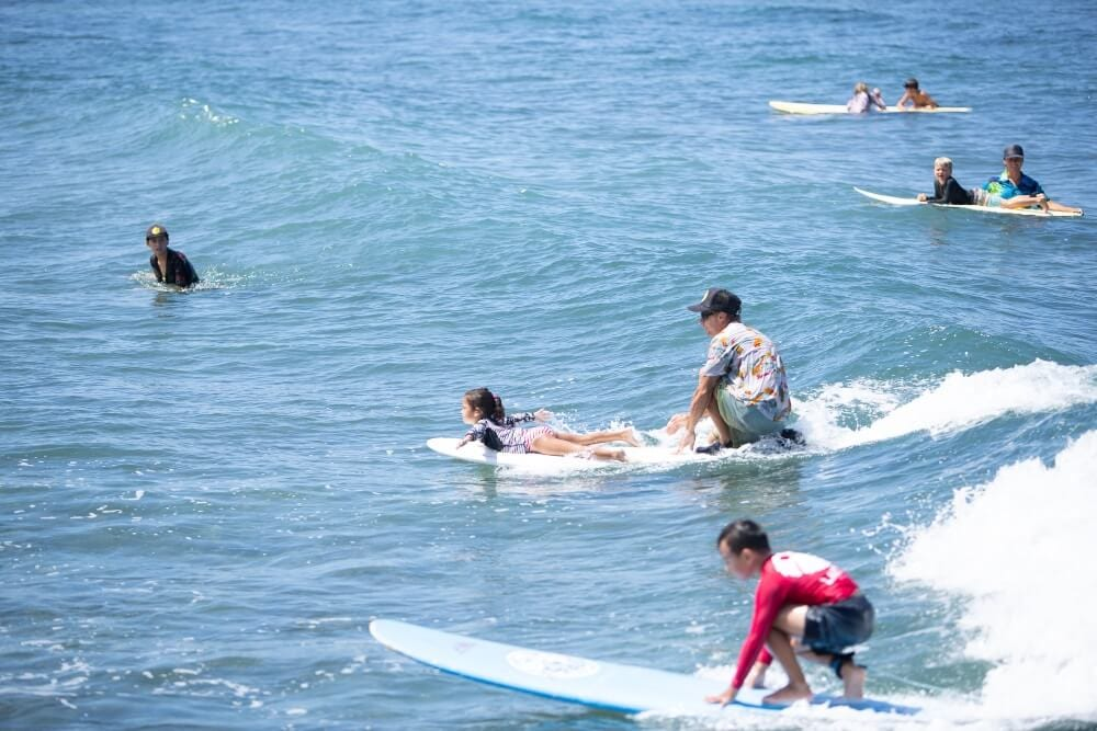 Surf camp at breakwall in Lahaina, Maui
