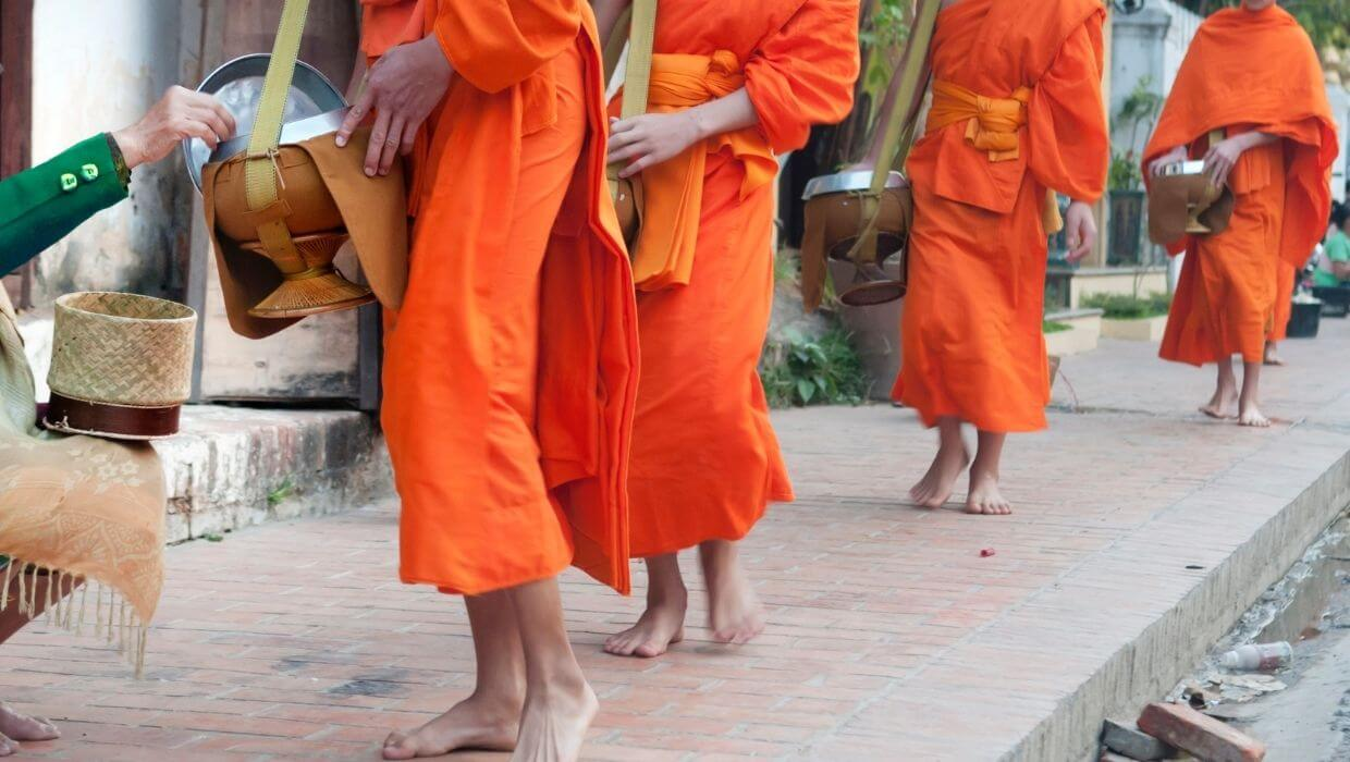 Giving alms to the monks in Luang Prabang, Laos