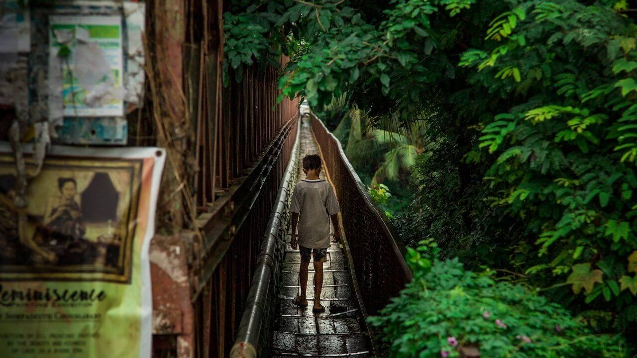 Boy on a bridge in Luang Prabang Laos