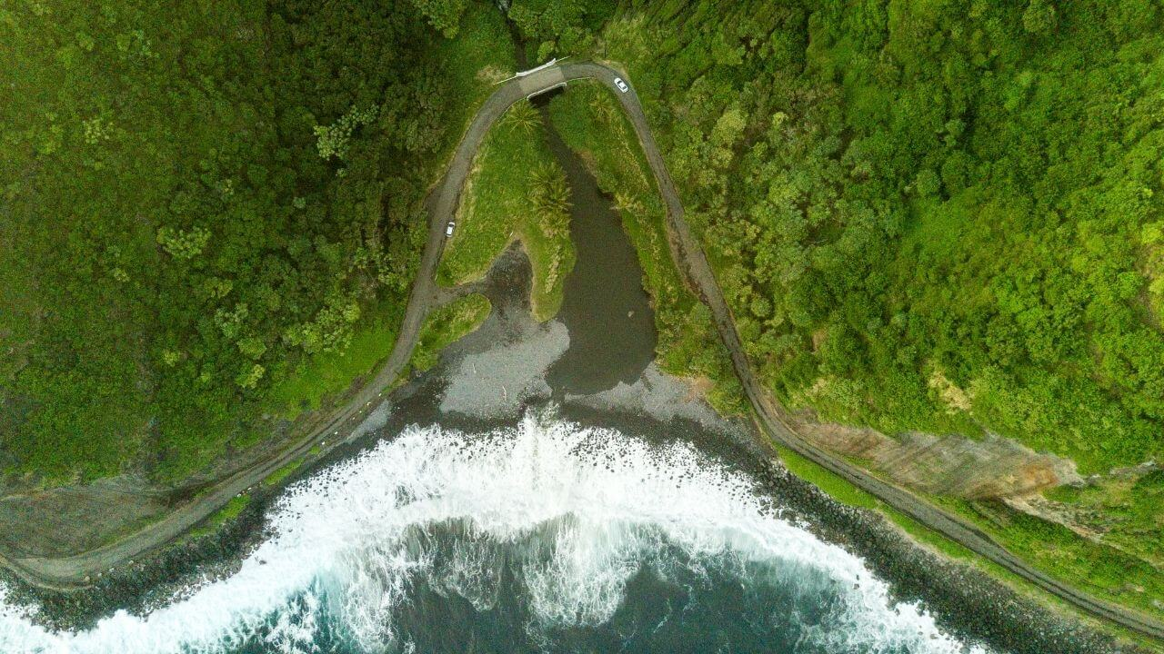 Lush Maui from above with waves crashing into the shore