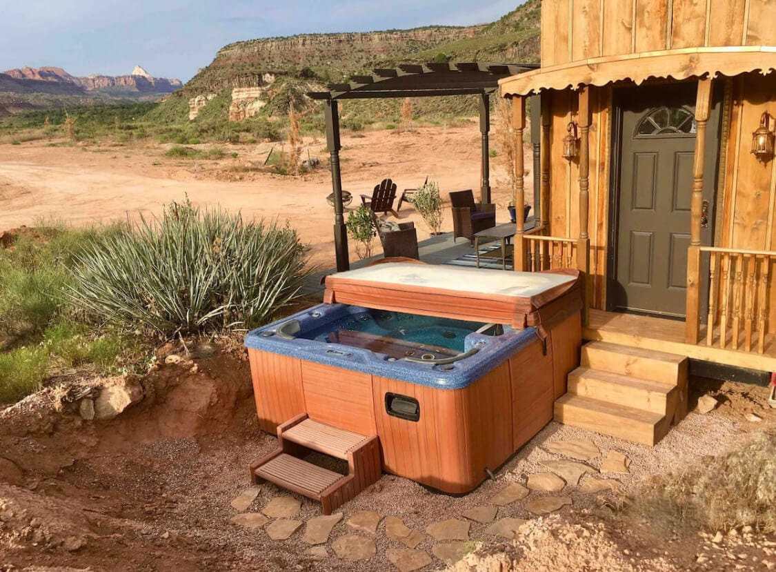 Outside of the Ark with views of the red rock and a hot tub
