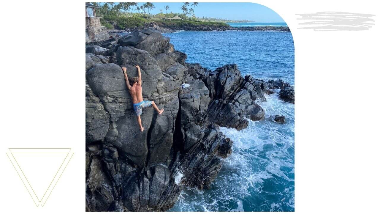 Man climbing up a cliff in West Maui